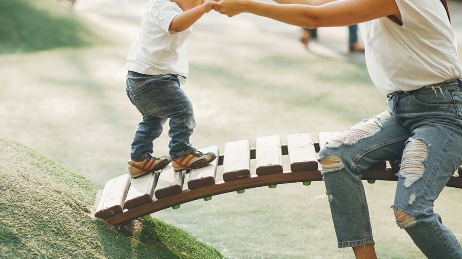 Woman and child playing in park