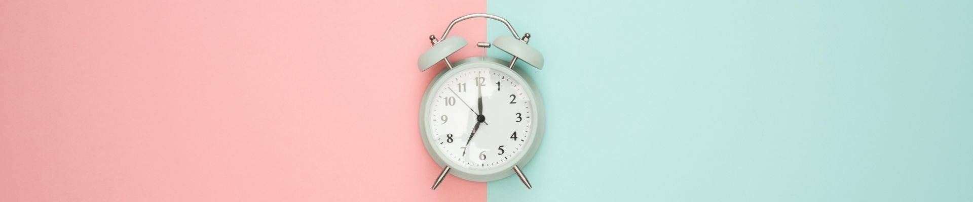 clock with pink and green background