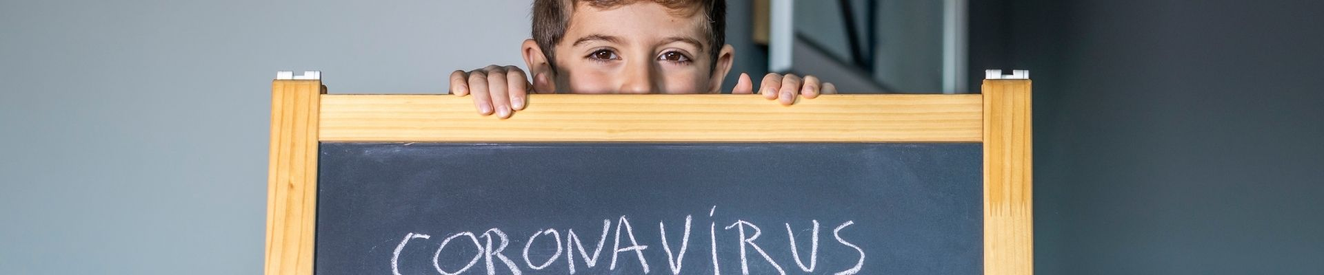 Little boy with Coronavirus sign