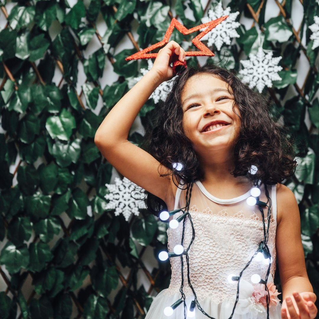 Girl with Christmas decoration